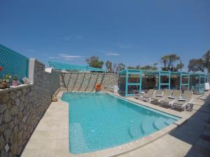 The swimming pool at or near Villa Rose