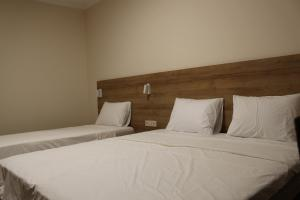 A bed or beds in a room at Boutique Hotel 32
