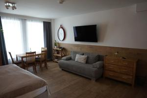 A television and/or entertainment center at Hotel Domizil