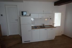 A kitchen or kitchenette at Hotel Domizil