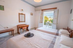 Ένα ή περισσότερα κρεβάτια σε δωμάτιο στο Ξενοδοχείο  Ειρήνη