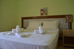 Ein Bett oder Betten in einem Zimmer der Unterkunft Apartments Dimitra