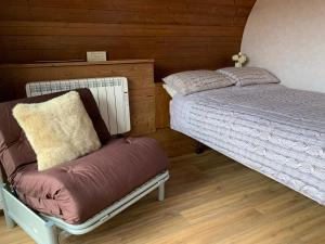 A bed or beds in a room at AC/DC Glamping