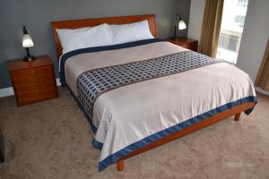 A bed or beds in a room at Beach Motel