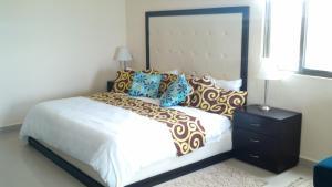 Cama o camas de una habitación en Baru Luxury Homes Riviera Maya