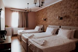 A bed or beds in a room at Lighthouse Hotel