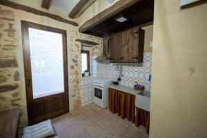 A kitchen or kitchenette at Casa Rural Pradas