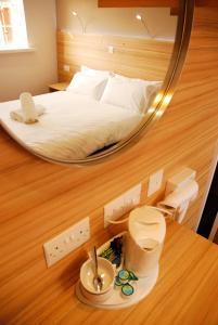 Un ou plusieurs lits dans un hébergement de l'établissement Botanic Rest Queens Quarter