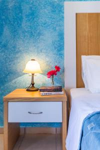 A bed or beds in a room at Aeolos Hotel