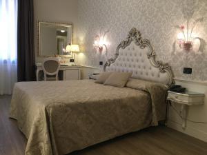 Cama ou camas em um quarto em Hotel Gorizia a La Valigia