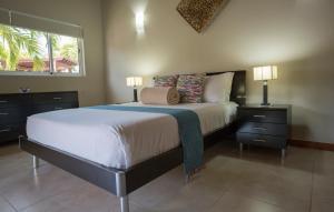 A bed or beds in a room at Costa Esmeralda Village