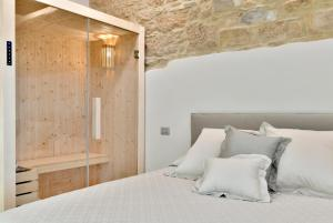 A bed or beds in a room at Amnis suites