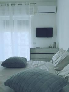 A bed or beds in a room at Adele's House