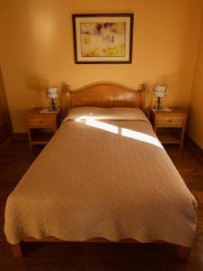 Ein Bett oder Betten in einem Zimmer der Unterkunft Casa De Aida