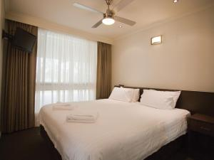 A bed or beds in a room at Rich River Golf Club Resort