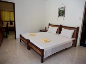 A bed or beds in a room at Alona Vida Beach Resort