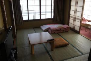 A seating area at Miyoshiya Ryokan