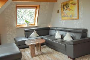 Ein Sitzbereich in der Unterkunft Ferienwohnung Sonne & Sauna