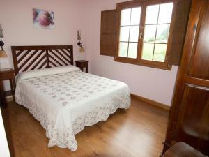 Cama o camas de una habitación en Apartamentos Rurales Casa Tata