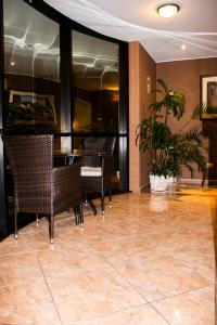The lobby or reception area at Solis Dies Hotel
