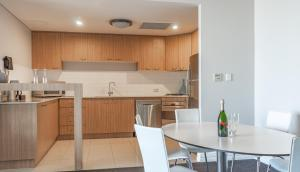 A kitchen or kitchenette at Mullaloo Beach Hotels & Apartments