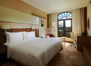 A bed or beds in a room at Novosibirsk Marriott Hotel