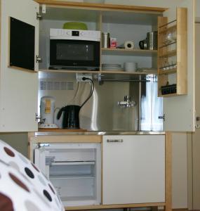 Küche/Küchenzeile in der Unterkunft De Duintop