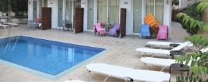 The swimming pool at or near Mimosa Suites