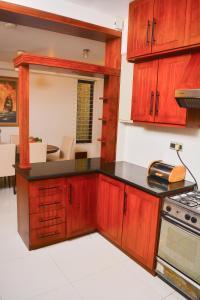 A kitchen or kitchenette at Unique Towers Luxury Boutique Suites