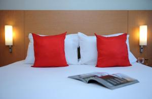 A bed or beds in a room at Ibis Tanger City Center