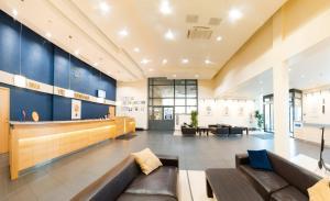 The lobby or reception area at Park Hotel Latgola