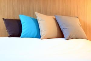 Un ou plusieurs lits dans un hébergement de l'établissement Villa Martégale Hôtel Restaurant