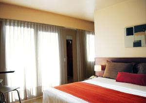A bed or beds in a room at Palermo Suites Buenos Aires Apartments