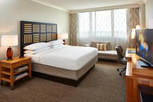 A bed or beds in a room at Renaissance Orlando Airport Hotel