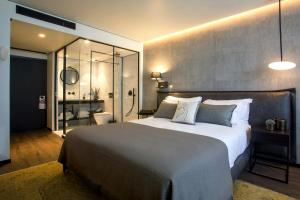 A bed or beds in a room at Daniel Herzliya Hotel