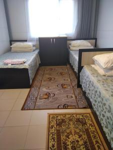 Кровать или кровати в номере  Гостевой Дом Виктория на Морской