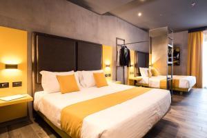 Cama ou camas em um quarto em J24 Hotel Milano