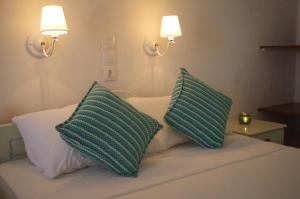 A bed or beds in a room at Esperos Hotel
