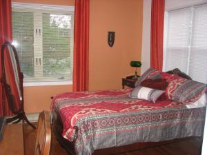 Кровать или кровати в номере Magnolia B&B