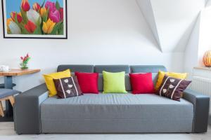 Łóżko lub łóżka w pokoju w obiekcie Tulip-Apartments - Jagiellońska 24 poddasze bez windy