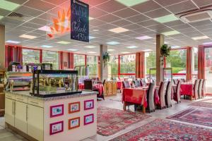 Restaurant ou autre lieu de restauration dans l'établissement Hotel Restaurant Siatel Chateaufarine