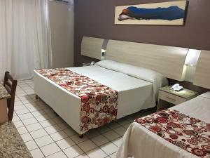 A bed or beds in a room at Sued's Plaza