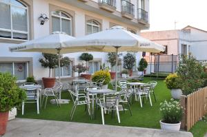 A restaurant or other place to eat at Hotel Casa Portuguesa