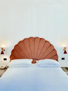 A bed or beds in a room at Demidoff Hotel Milano