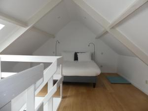 A bed or beds in a room at Ilot Sacre Apartments