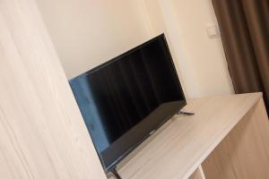 A television and/or entertainment center at Comfy Apartments-Ohrid