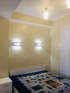 Кровать или кровати в номере Квартира У моря, с видом на горы