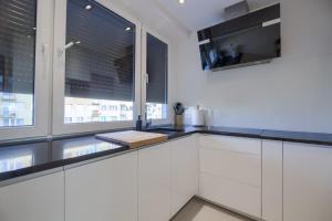 A kitchen or kitchenette at Własne M