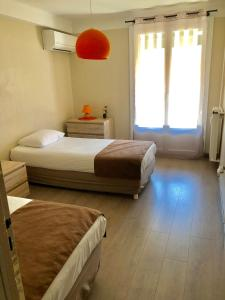 A bed or beds in a room at CATALANS 1,5Km/Vieux-Port