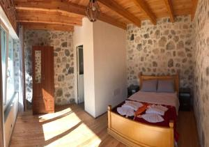 A bed or beds in a room at Thethi Paradise